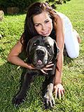 Naughty teen Kiki posing with huge dog outdoors